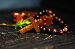 Christian cross necklace on darck background - as a symbol of the beginning of Great Lent, Ash Wednesday