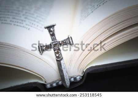 Christian cross necklace on Holy Bible book, Jesus religion concept as good friday or easter festival