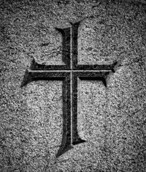 Christian cross on stone surface