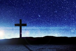 Christian Cross on the field with a night scene background