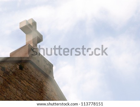Christian cross on the roof and the light from the sky Conceptual image of a Christian spirituality