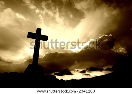 christian cross silhouette and the clouds in sepia tone #2341200