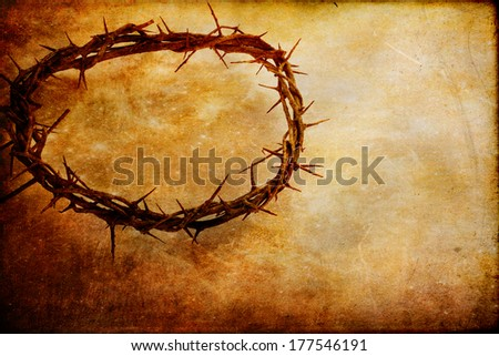 Christian crown of thorns like Christ wore over textured background with copy space. Stock photo ©