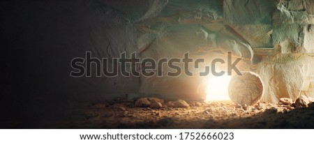 Christian Easter concept. Jesus Christ resurrection. Empty tomb of Jesus with light. Born to Die, Born to Rise. 'He is not here he is risen'. Savior, Messiah, Redeemer, Gospel. Alive. Miracle. ストックフォト ©