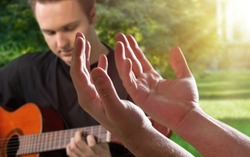 Christian Families Worshiping God with a melodious guitar playing and the bible