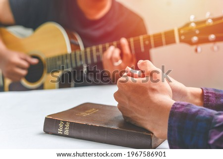 Christian family worship God in home, with a guitar and the Holy Bible. praise and worship concept