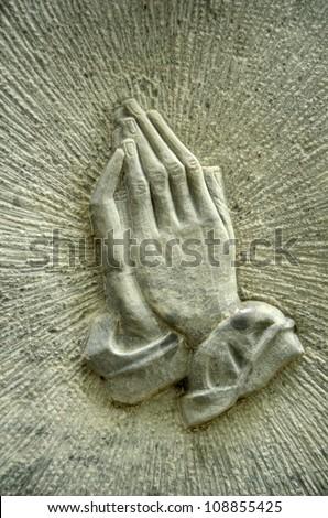 Christian Image Of Jesus' Praying Hands On A Gravestone
