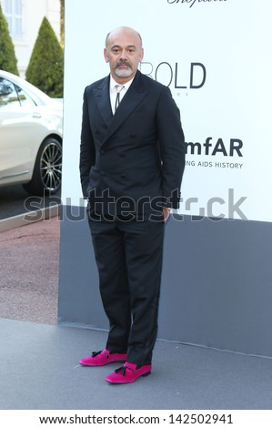 Christian Louboutin at the 66th Cannes Film Festival - amfAR's 20th Annual Cinema Against AIDS - Arrivals, Cannes, France. 23/05/2013