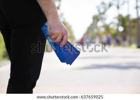 Christian Man Distributing Evangelistic Flyers in The Park #637659025