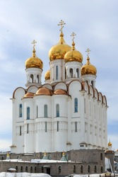Christian temple. Beautiful large white building with golden domes and crosses. Russian Orthodox Church. Holy Trinity Cathedral, Magadan, Siberia, Far East of Russia.