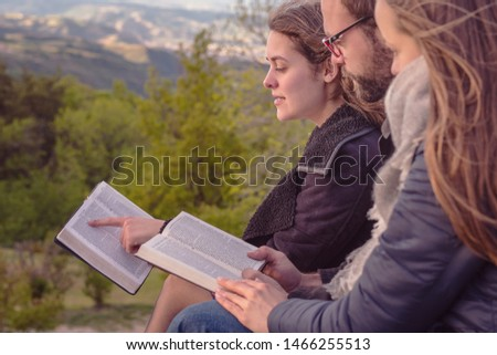 Christian worship and praise. Friends praying and reading the bible in the evening. #1466255513