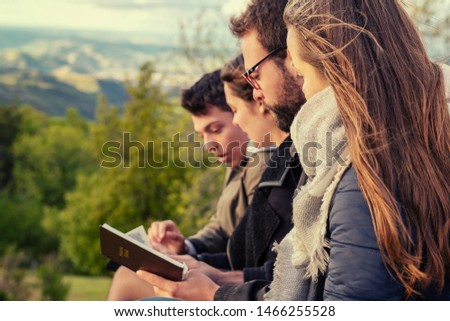 Christian worship and praise. Friends praying and reading the bible in the evening. #1466255528