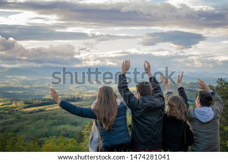 Christian worship and praise. Group of friends hugging outdoors at sunset. #1474281041