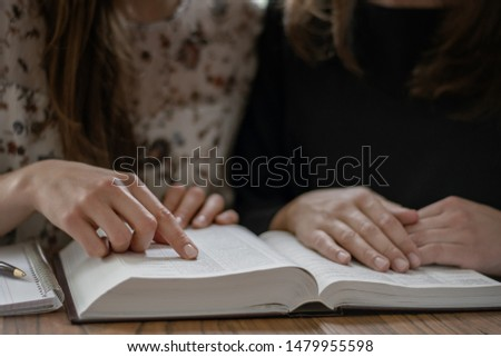 Christian worship and praise. Happy friends reading the bible together. #1479955598
