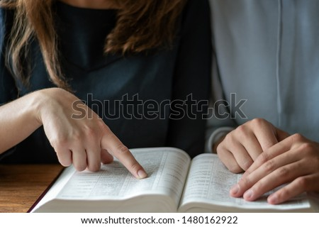 Christian worship and praise. Happy friends reading the bible together. #1480162922