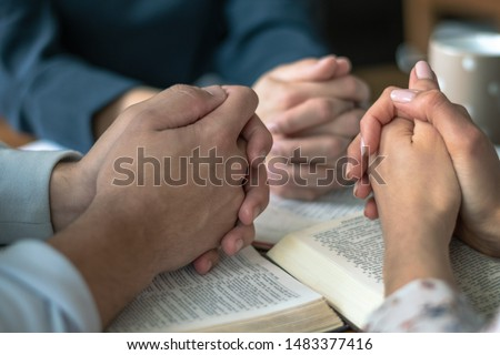 Christian worship and praise. Happy friends reading the bible together. #1483377416