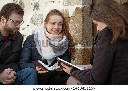 Christian worship and praise. Happy friends reading the bible together in the evening. #1468451159