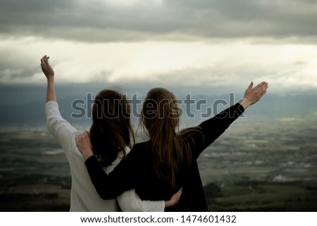 Christian worship and praise. Two young woman are praying and worshiping in the evening. #1474601432