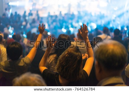 Christian worship with raised hand and pray in the worship concert. Stock photo ©