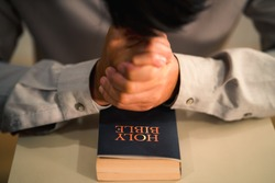 christianity background of holy bible on table in chruch and man praying for god blessing