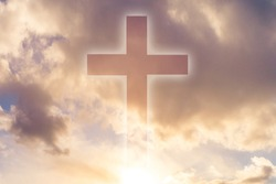 Christianity. Religious cross on the background of the sky. Silhouette of a catholic cross in the clouds. Concept - an appeal to God. Belief in religion. Concept - catholic Church. Sacred