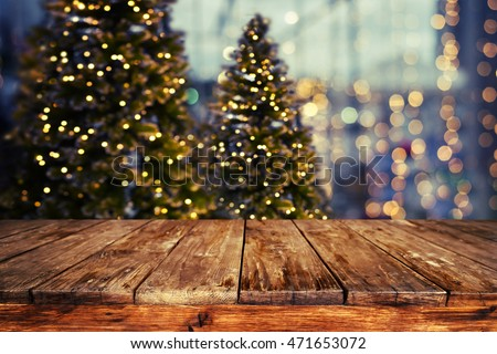 Christmas abstract blur background - light bokeh from Xmas tree at night party in winter. vintage color tone stock photo