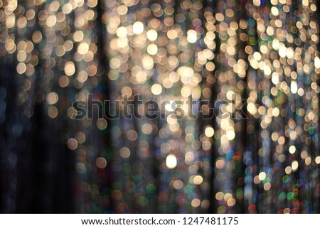 Christmas Abstract Glitter Gold Background. Festive Holiday Glowing Bokeh Backdrop With Tinsel. Blurred Golden Bokeh.    #1247481175