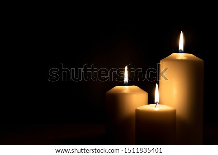 Christmas advent candle light in church with blurry golden bokeh for religious ritual, spiritual zen meditation, peaceful mind and soul or funeral worship ceremony