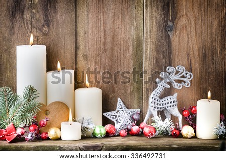 Christmas Advent candles with festive decor. #336492731
