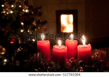 Christmas advent wreath with burning candles - stock photo
