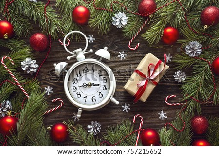 Christmas alarm clock with pine branches and decorations. Christmas timer. Time to celebrate. #757215652