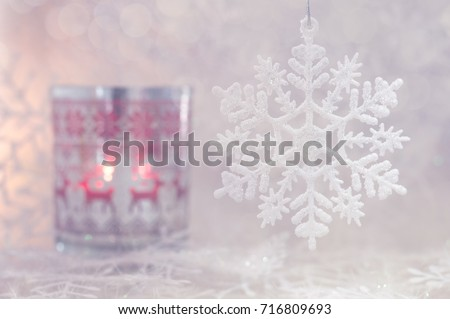 Christmas and a snowflake. Christmas candle with deer ornament and snowflakes. Selective focus #716809693