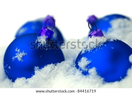 Christmas  and blue glass balls on fresh white snow