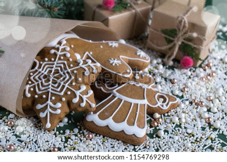 Christmas and holiday baking . Ginger cookies with decor on  green  background. #1154769298