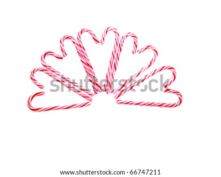 christmas and holiday candy canes isolated on white, with room for your text