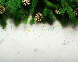 Christmas and New Year background. Christmas tree branch on a white background. A gift for the family. View from above. Copy space.