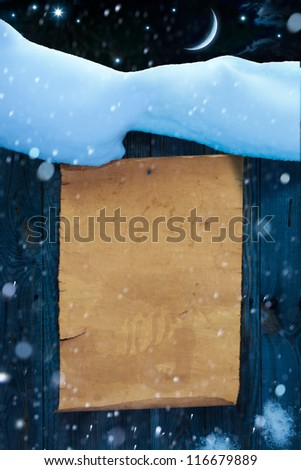 Christmas and New Year background, snow covered paper scroll