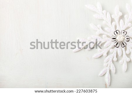 Christmas and New Year background Snowflake on a white wooden background Copy space