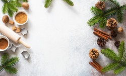 Christmas and New Year background with baking ingredients, cones and fir twigs. Flat lay. Copy space
