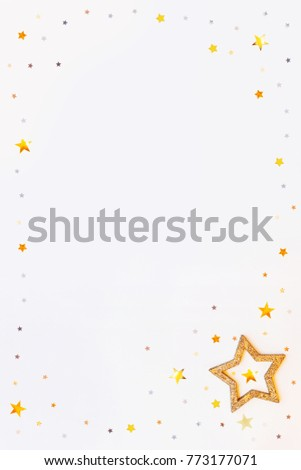christmas and new year background with sparkling golden stars frame and confetti holiday symbols on