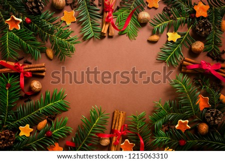christmas and new year border design on the brown background with fir tree and orange dry