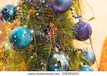 Christmas and New Year Decoration. Christmas ball hanging on a Christmas tree. Bright garlands and snow