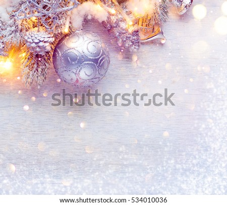 Christmas and New Year Decoration over white wood background. Border art design with holiday baubles. Beautiful Christmas tree closeup decorated with ball, holly berry, tinsel. Pastel colors, vintage #534010036
