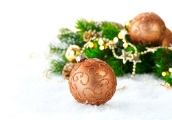 Christmas and New Year Decoration over white wood background. Brown Border art design with holiday baubles. Beautiful Christmas tree closeup decorated with ball and garland. Golden color, vintage