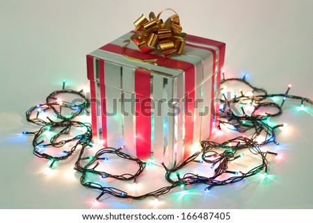 Christmas and New Year gift with bright lights garland