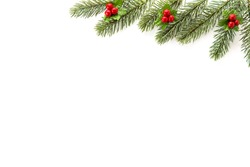 Christmas and New Year holiday  background top view border design with green pine, mistletoe, red berries and copy space on white background