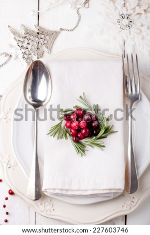 Christmas And New Year Holiday Table Setting with cranberry and rosemary decoration,-Holiday decoration.