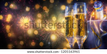 Christmas and New Year holidays background with champagne #1205163961