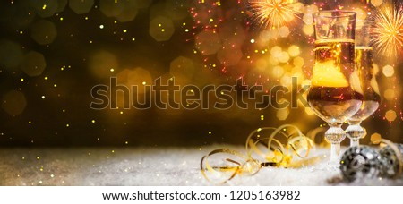 Christmas and New Year holidays background with champagne - Shutterstock ID 1205163982