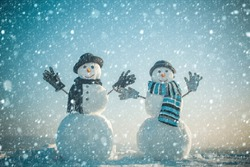 christmas and new year snow concept Xmas or christmas party. Snowman gentleman in winter black hat, scarf and gloves. Happy holiday celebration. New year snowman spy agent. Christmas and winter